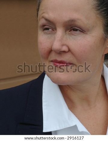 Businesswoman in her late fifties, looking confident and calm - stock photo