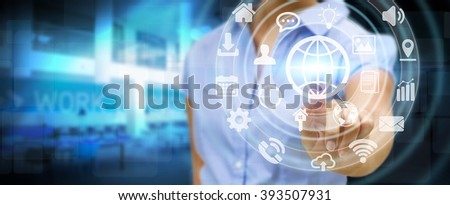 Businesswoman in his office using a digital tactile screen interface with web icons