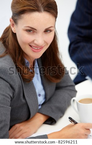 Businesswoman in meeting - stock photo