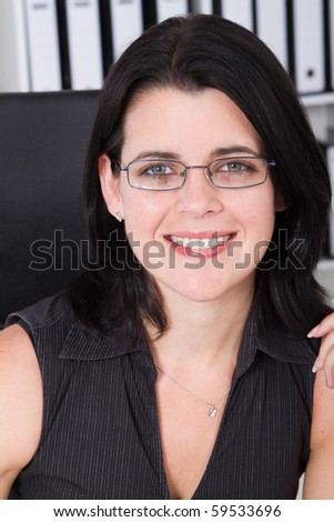 businesswoman in office - stock photo