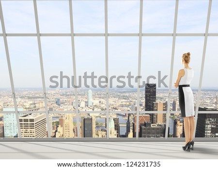 businesswoman in office and city views - stock photo