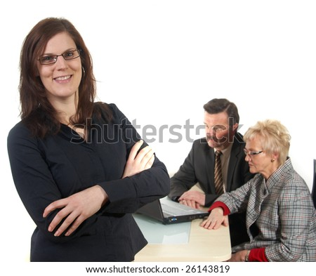 Businesswoman in office environment. Three people with focus on young woman in front. Isolated over white.