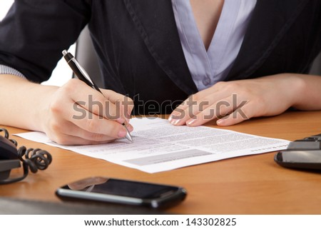 Businesswoman in office, signatory