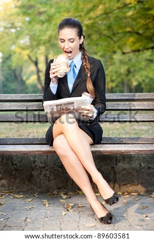 businesswoman in park  having breakfast - stock photo