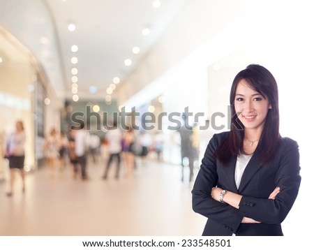 businesswoman in shopping mall  - stock photo