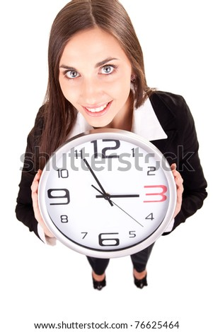 businesswoman in suit holding a clock and showing time, isolated on white - stock photo