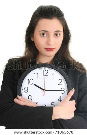 Businesswoman in suit holding a clock over white - stock photo