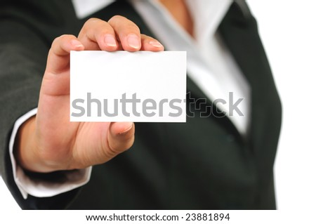 Businesswoman in suit holding empty business card. Isolated on white. - stock photo