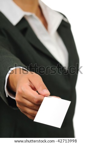 Businesswoman in suit holding empty business card. Isolated on white.