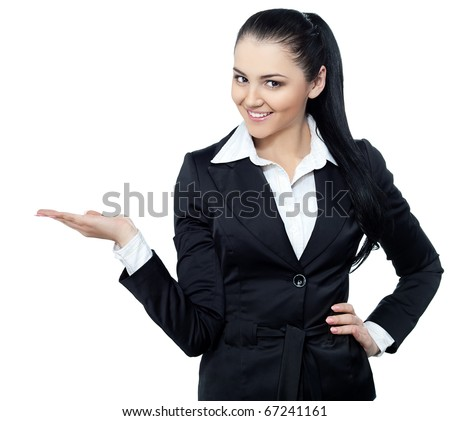businesswoman in suit outstraching her hand for presenting something - stock photo