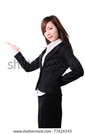businesswoman in suit outstretching her hand for presenting something