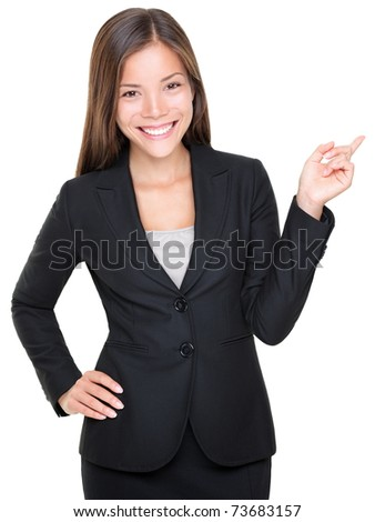 Businesswoman in suit pointing smiling. Isolated on white background. Asian Caucasian female model. - stock photo