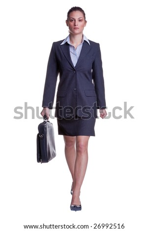 Businesswoman in suit walking towards carrying a briefcase, isolated on white background. - stock photo