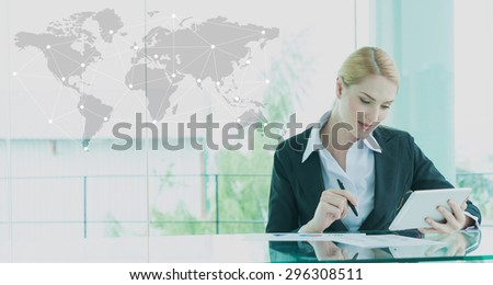 businesswoman in suit working with tablet, business globalization concept - stock photo