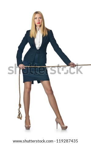 Businesswoman in tug of war concept - stock photo
