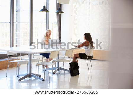Businesswoman interviewing a job applicant - stock photo