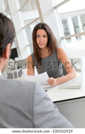 Businesswoman interviewing job applicant - stock photo
