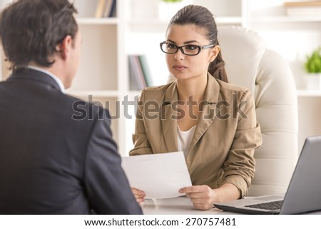 Businesswoman interviewing male candidate for job in office. - stock photo