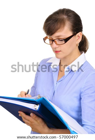 Businesswoman is checking the inventory and making notes - stock photo
