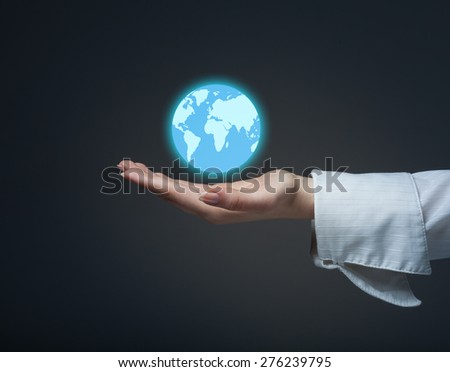 Businesswoman is holding globe, Africa and Asia view. Elements of this image furnished by NASA - stock photo
