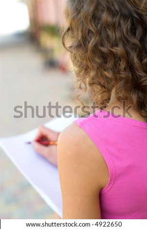 Businesswoman is preparing for annual report outdoors - stock photo