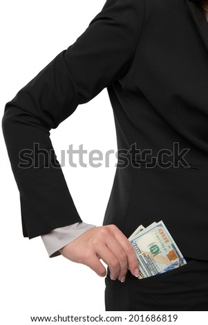 Businesswoman is putting money in her pocket - stock photo