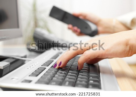 Businesswoman is typing on keyboard and answer the call. customer service concept - stock photo