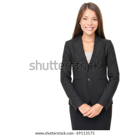 Businesswoman isolated on white background. Young smiling Asian / Caucasian business woman in suit standing looking at camera