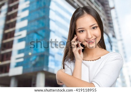 Businesswoman isolated with mobile phone - stock photo