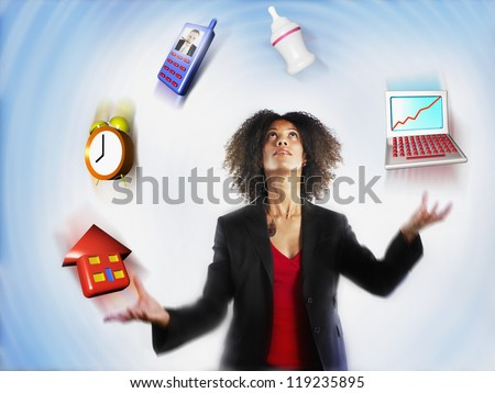 Businesswoman juggling responsibilities over colored background - stock photo