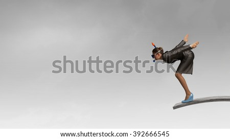 Businesswoman jumping in water - stock photo