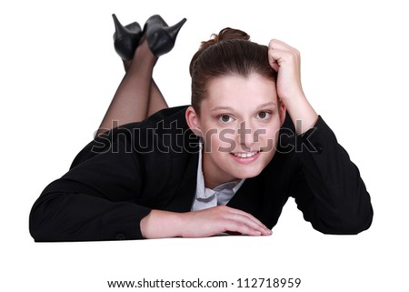 Businesswoman laying on the floor - stock photo