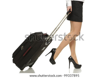 Businesswoman legs with a suitcase on the white background - stock photo