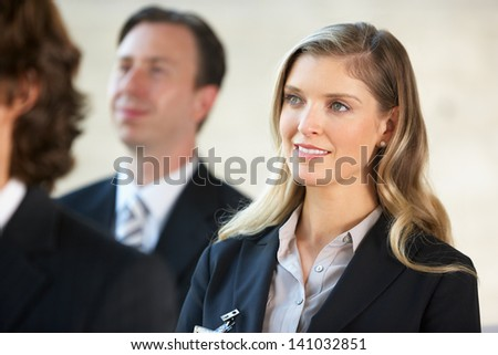 Businesswoman Listening To Speaker At Conference - stock photo