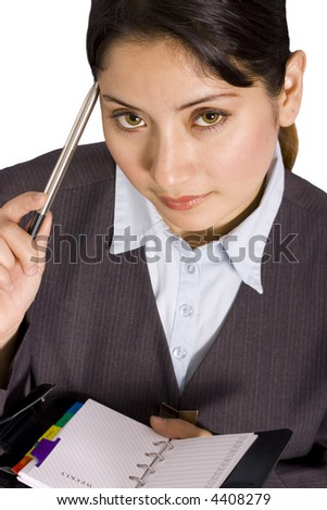 Businesswoman looking at her schedule and thinking