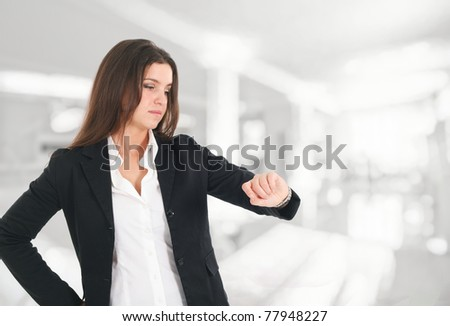 Businesswoman looking at her watch - stock photo