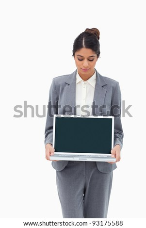 Businesswoman looking at laptop in her hands against a white background - stock photo