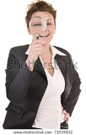 Businesswoman Looking Into A Magniying Glass - stock photo