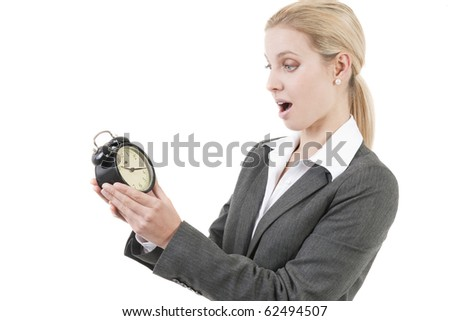Businesswoman looking shocked at the clock