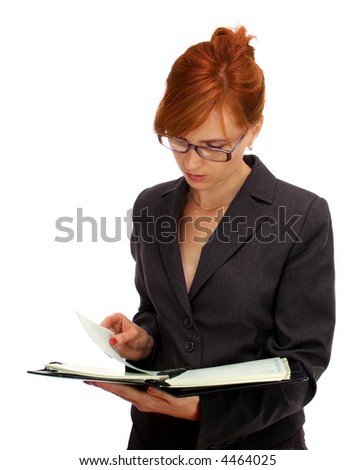 businesswoman looking through a diary - stock photo