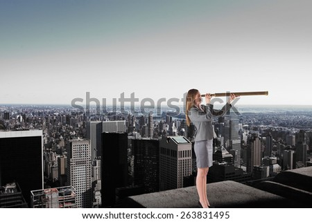 Businesswoman looking through a telescope against high angle view of city skyline