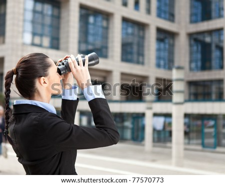 businesswoman looks into the future or observe competition - stock photo