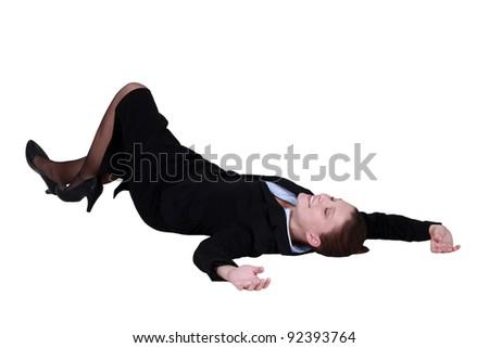 Businesswoman lying on the floor - stock photo