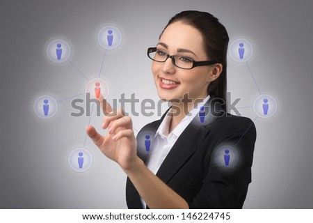 businesswoman managing her contact network, pressing hi-tech buttons