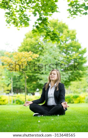 Businesswoman meditating and Yoga in a park