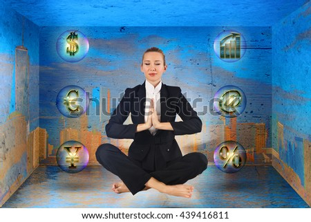 Businesswoman meditating in the box - stock photo