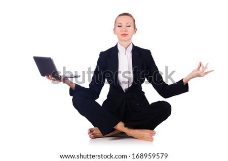 Businesswoman meditating isolated on white - stock photo