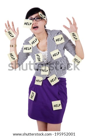 Businesswoman need help with notes stick on her body - stock photo