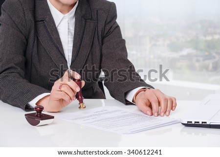 Businesswoman notarize document at notary public office