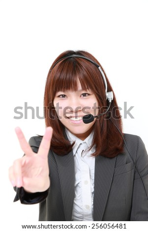 businesswoman of call center showing a victory sign - stock photo